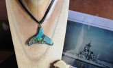 Adorn the beautiful whale tale necklace by Cafe Arte and the rubber ducky pin by Enchanted Chic!