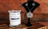 Smell the sea with a sea salt candle by Artisan Candle Co. and feel it with sterling silver sand dollar necklace and earrings by Astralcreaciones.