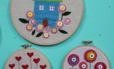 Bring a little spring to your walls with some crafty embroidered blossoms by Grace & May.